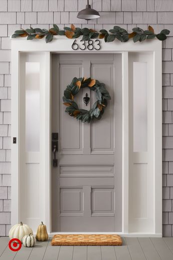 Go faux this fall. From bright yellows and oranges to subdued green, we have a faux wreath for every front door.