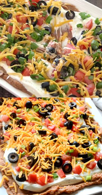Layered Ranch Taco Dip – layers of refried beans, sour cream with ranch, tomato, olives, cheese, and more! No cooking involved!