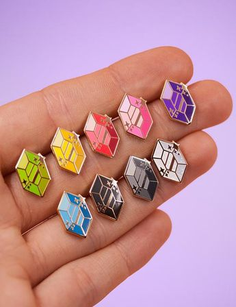 Those Zelda inspired gems can be used anywhere and are sure to get the conversation going! Buy one or the set of 5 different colors at a discounted price ! Collect them all to add some flair to your jacket or bag <3- Size: 15mm - Sold as a set of 5 or individually- Also a set of black, silver and white available!- G