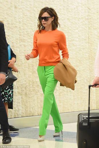 Victoria Beckham makes a statement in orange and green