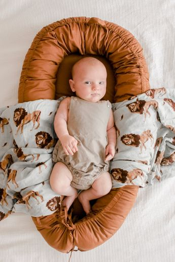 A beautiful organic baby lounge. Perfect as a place to rest for your baby, a baby nest, tummy time and more A beautiful organic baby lounge. Perfect as a place to rest for your baby, a baby nest, tummy time and more