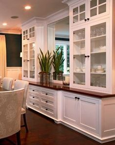 The extension from kitchen; what to build against the dining room wall. Cabinets, countertop, mirror backdrop, shelves.