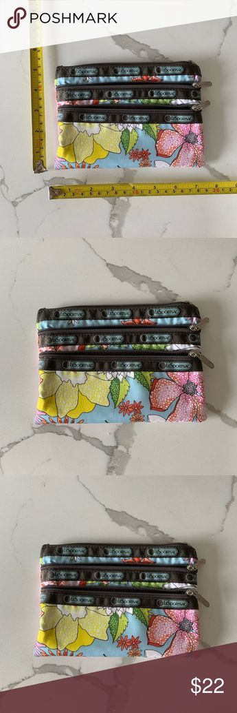 Lesportsac 3 Pocket Makeup Bag Floral Print Very gently used 3 pocket makeup bag. Cute flower print, tropical vibes ! Perfect for travel or just to have in your everyday bag 🎉 Lesportsac Bags Cosmetic Bags & Cases