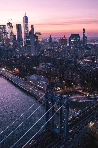 Over NYC by Roberto Nickson