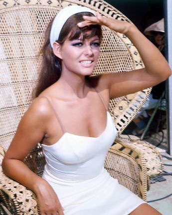 Claudia Cardinale...love the white dress with the white headband. So perf