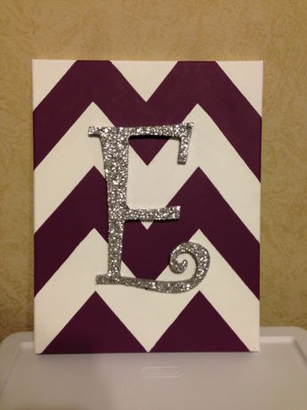 Painted canvas with a glittered wooden letter! -tape off your chevron pattern and paint -remove tape and paint 2nd color -paint a base coat on to the letter -modge podge letter then add glitter on top -apply epoxy to the back of the wood letter and press it on to your canvas  -let glue dry for a while (I let it dry overnight)