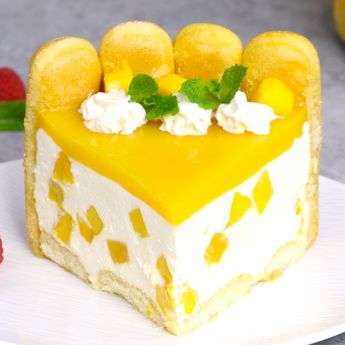 No Bake Mango Cheesecake – the most beautiful and unbelievably delicious mango cheesecake. All you need is some simple ingredients: mango juice, ladyfingers, cream cheese, sugar, whipped cream, mango and gelatin. Perfect for a holiday party or a special occasion such as birthday and Mother's Day! #MangoCheesecake #NobakeCheesecake