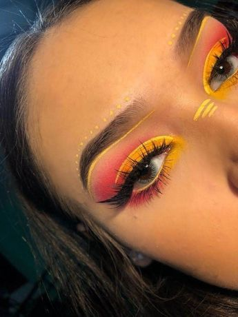 Orange Festival Makeup with blue contacts and pretty false lashes