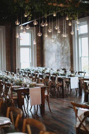 Wedding reception decor + hanging Edison bulbs + hanging greenery  {Christina Logan Design}