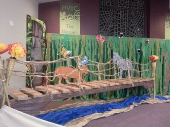 VBS Safari Jungle bridge with river under. Cardboard wood planks, paper vines and cardboard cut out tiger and zebra.