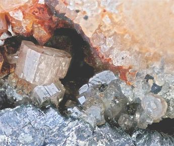 Phosgenite, Wheal Sally, Porthtowan, Cornwall, England, UK. Crystals of blocky to tabular Phosgenite mostly fill a cavity in a Galena-Quartz matrix. Largest crystal almost 3mm, with a slight pink tint.   Size      4.6 × 3.7 × 2.3 cm