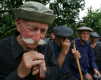 Men crying during the funeral of an Abkhaz soldier.