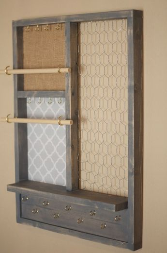 This grey distressed handmade jewelry organizer is perfect for organizing all of your jewelry. Why store your beautiful jewelry in messy drawers where they rarely see the light of day? No longer cringe in fear as you reach for your favorite necklace tangled in a knot more