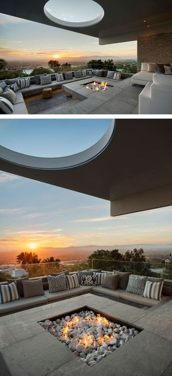 This modern house has a sunken lounge and entertainment area with outdoor furniture that wraps around a fireplace. An overhang from the upper floor of the home provides shade, while the skylight sculpts the natural light. ☑☑--- Visit Home Decor Shop HERE -☑☑ #home decor ideas #home decor diy #home decor on a budget #quirky home decor #modern home decor #home decor apartment #rustic home decor #home decor living room #home decor bedroom #home decor styles #home decor cozy #vintage home decor #hom