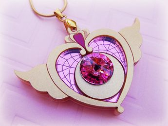We can't get over this GORGEOUS Sailor Moon compact necklace!