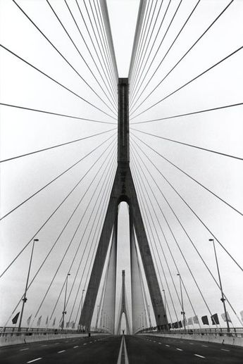 By Marc Riboud. China. Shanghai. 1993. Yangpu Bridge.