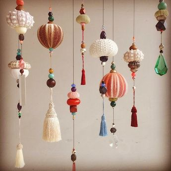 """Mobiles by Frederikke Aagaard (but you could do this yourself like im gonna do) ps. Those """"shells"""" are actually sea urchin skeletons!"""