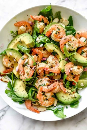 This simple and flavorful salad makes the perfect meal-prep meal for lunch or dinner with citrus shrimp, creamy avocado, and the crunch of sliced almonds.