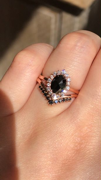 We're obsessed with Black Diamond Styles! Whether it's in wedding bands or mixed with white diamonds in a Halo Engagement Ring like this, we can't stop! See more from our Black Diamond Ring collection ~ #rings