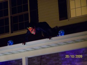 Halloween Rooftop Decorating - maybe a different mask but I like the guy looking over the roof like that.