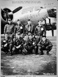 Lt. Mazzechelli and Crew of the Boeing B-17 Flying Fortress 'I'll Get By' of the 390th Bomb Group pose at their base in England. 13 Nov 1944.