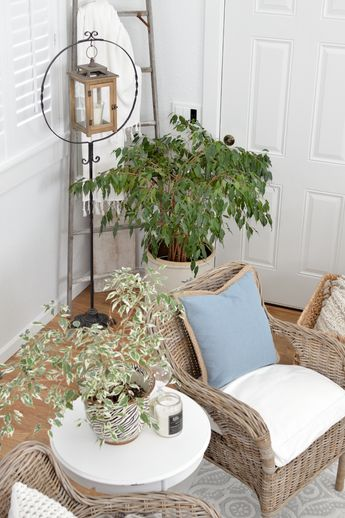 New Home Decorating Tips and Ideas | Use an antique bird cage a lantern stand! Wood and metal lantern from the Better Homes & Gardens collection at Walmart. Potted ficus, white walls, wood floors and neutral wicker chairs. #bhg #bhghome  #bhgatwalmart #ad #homedecorideas #decoratingideas #homedecoratingideas