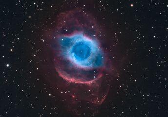 The Helix Nebula. It looks like a giant eye, doesn't it? Gives me the creeps, but I like it!