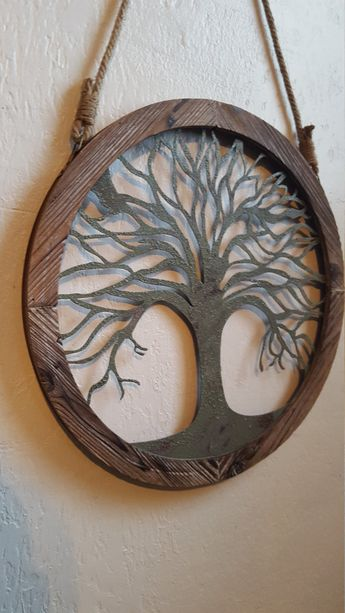 This Beautiful Wood and Metal Tree wall décor would make a grand statement in any room. Measures 18 in diameter and hangs 32 including the rope. We are showing this in distressed Sage Green. This listing is for a Distressed finish, however if you would like it Non-Distressed please leave a message at checkout. - Please note due to different monitors/screens colors may vary slightly in person- -- The outer wood area may vary slightly lighter or darker than shown in our photo. ~~ Ple...