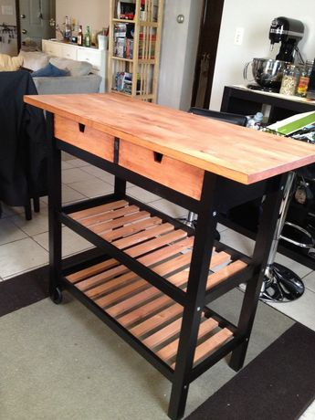 Kitchen cart except dusty blue instead of black, and dark wood finish instead of the light wood.