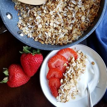 Make delicious coconut granola in just a few minutes on the stove top. Then top your yogurt and add some berries for a perfect quick breakfast. This is one of our favorite ways to enjoy our oatmeal!#breakfast#brunch#oatmeal#granola#coconut