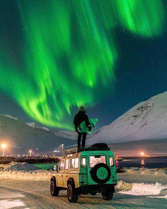 Surfing under northern lights in Iceland  📷Chris Bukard / IG