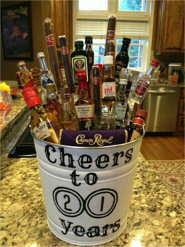 Cheers to 21 years alcohol basket for him instead of making him a cake... unless he likes cake then make him a cake to