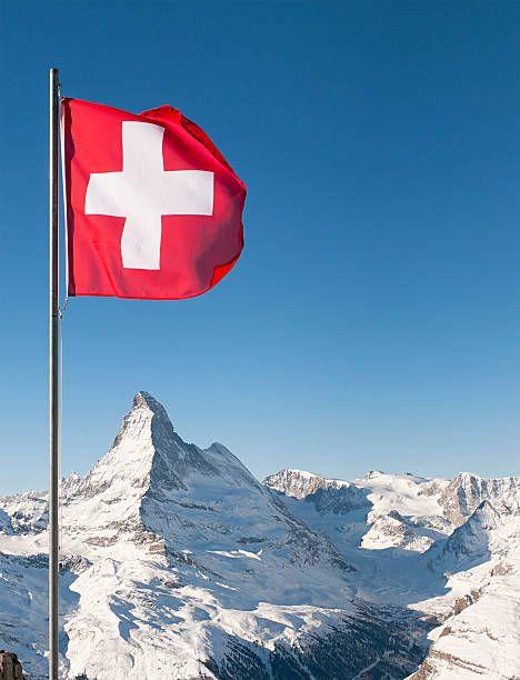 The White On Red Cross Of The Swiss National Flag Flying Above The Swiss Flag Switzerland Military Matterhorn