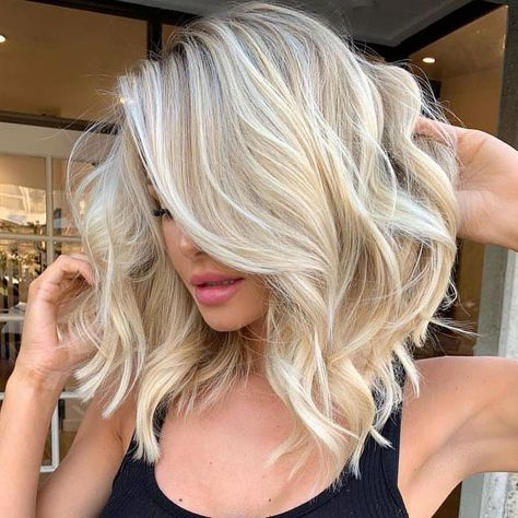 * The More You Know 🌈🌈🌈 ...Filtered vs. unfiltered so you can see what this color looks like in reality. And then we went short ✂️✂️ by @hairbykristingrip ・・・ @akatharinav 😻 #behindthechair #btchairbykristingrip #blondedimension #dimensionalblonde #lob #shortblondehair #bachelorinparadise #hairinspo #shorthaircut #bob #ashyblonde #Bobhaircut