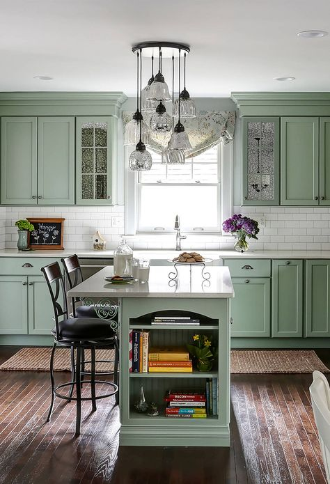 Sage Green Kitchen Cabinets With White Subway Backsplash We see subway backsplash, sage green cabinets, and quartz white countertop again in another transitional kitchen. Can't think of another combination of colors for a nostalgic transitional or farmhouse kitchens!