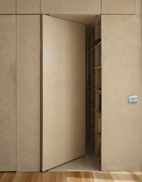 Modern strand board cabinet with an entrance to the bedroom