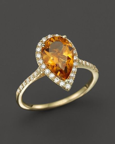 Pear Cut Citrine Engagement Ring:A pear cut hasn't ever been quite as popular as it is now. The cut on this ring is oh-so feminine and elegant. It's sure to give you butterflies every time you put it on your finger.  | Citrine and Topaz Engagement Rings