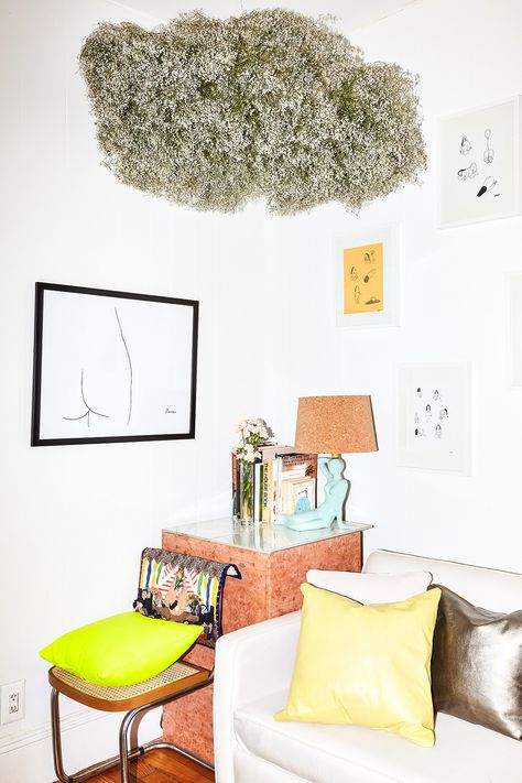 A plant on the ceiling adds a unique surrealistic touch to this Italian-inspired corner.