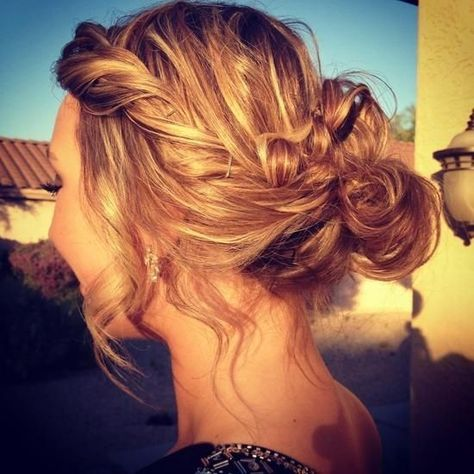 Messy Updo with a few loose strands around face. Really nice for a day at school, beach or just with a beautiful dress for a date