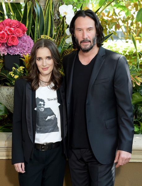 Winona Ryder (L) and Keanu Reeves attend a photo call for Regatta's 'Destination Wedding' at the Four Seasons Hotel Los Angeles.