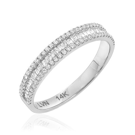 Set in 14k gold this channel set baguette band has a beautiful diamond border detail. SKU: R01003128 Total border diamond weight: 0.18ct Total baguette diamond weight: 0.16ct Other ring sizes are avai