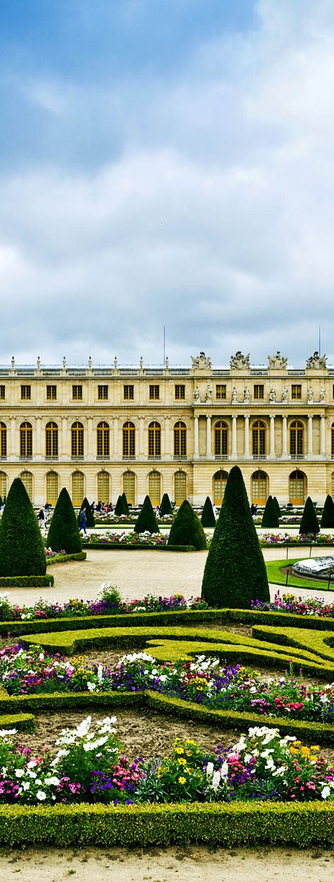 The palace of Versailles, France with beautiful gardens