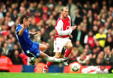 Freddie Ljungberg skips around John Terry at Stamford Bridge, 21/2/04. #Arsenal