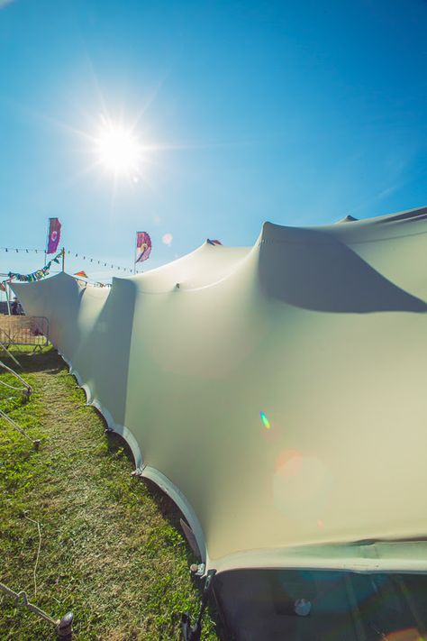 sunshine stretch tent shadows stretch marquee at bestival flags wooden poles stretch tent hire yorkshire & sunshine stretch tent shadows stretch marquee at bestival flags ...