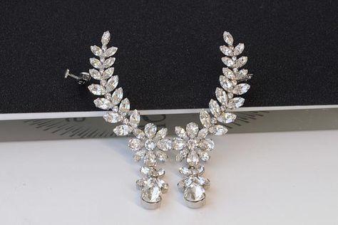 #jewelry #earrings #earjacketsclimbers #swarovskiearrings #climbingearrings #earclimberearrings #wrappedearrings #earcuffearrings #weddingearrings #brideearrings #clearcrystal #statementearrings #bigearcrawler #bridalearrings #swarovskiclusters #weddingcrystal