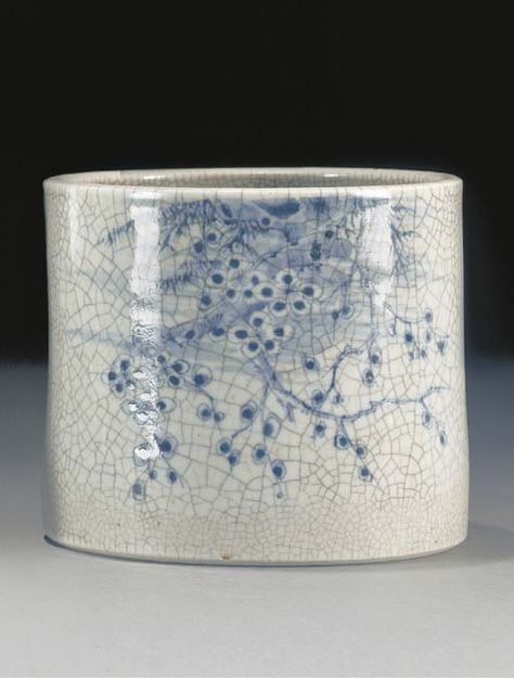 """""""A blue and white crackleware brushpot, 18th century  painted with trailing branches of prunus blossom, pine and bamboo, the reverse inscribed -- 6 3/8in. (16cms) diam."""""""