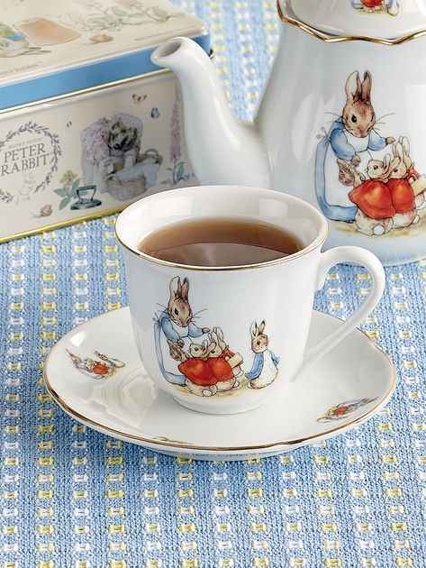 Peter Rabbit Porcelain Teacup and Saucer Add our collectible Beatrix Potter Porcelain Teacup and Saucer to your tea set. Made with fine German porcelain, this tea cup and saucer is hand detailed with real gold featuring Beatrix Potter's iconic artwork. Tea Cup Set, Tea Cup Saucer, Peter Rabbit, Beatrix Potter, French Tea, Coelho Peter, Cocoa, Tea Sets Vintage, Vintage Teacups