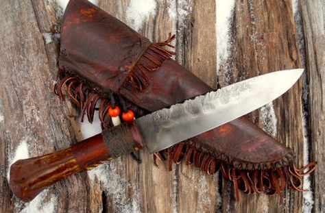 """Frontier Belt Knife. Deer leg bone grip with a rawhide wrap and a cord ferrule. Solid brass pins. 1095 high carbon steel blade. Filework and hammer marks. Comes with a decorated frontier, rawhide sheath. 10 5/8"""" overall."""