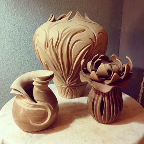 beautiful carved pottery flowing lines and curves, nouveau organic style.  Does anyone know the artist?