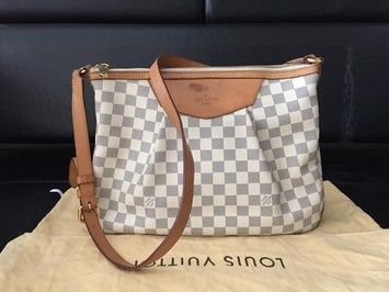 fa746dc37e22 Get the trendiest Cross Body Bag of the season! The Louis Vuitton Siracusa  Damier Azur Cross Body Bag is a top 10 member favorite on Tradesy.